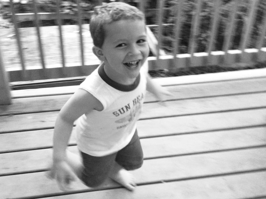 Little boy smiling while he's running fast